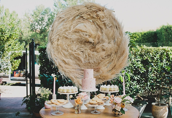 Full moon inspired pampas grass circle backdrop for wedding cake