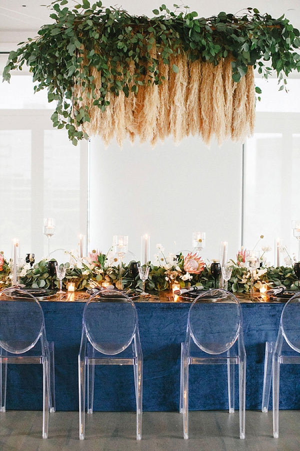 Suspended wedding table pampas grass chandelier with greenery