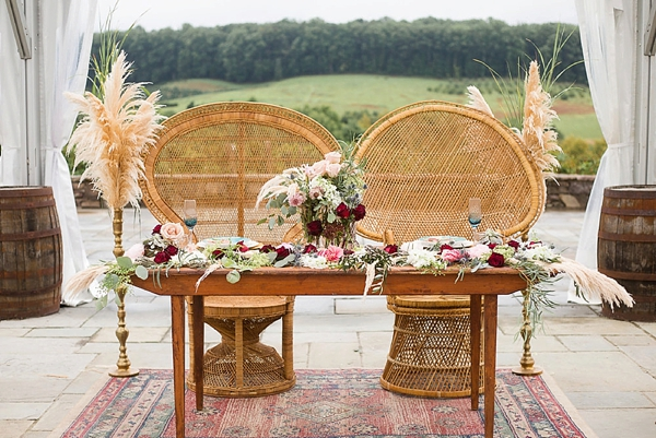 Pampas grass on brass pedestals for sweetheart wedding table details
