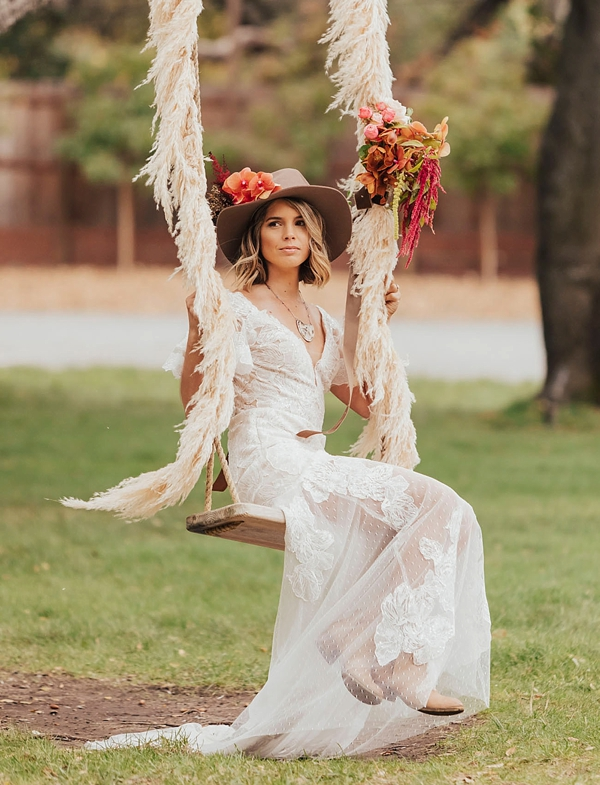 Cute rustic swing with pampas grass details for bridal portraits