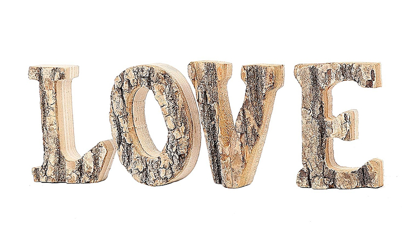 Adorable wedding wood LOVE sign with a tree bark texture