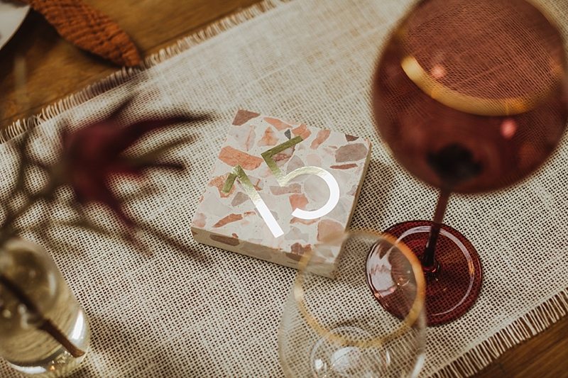 Pink terrazzo block with gold inlays for stylish wedding table numbers