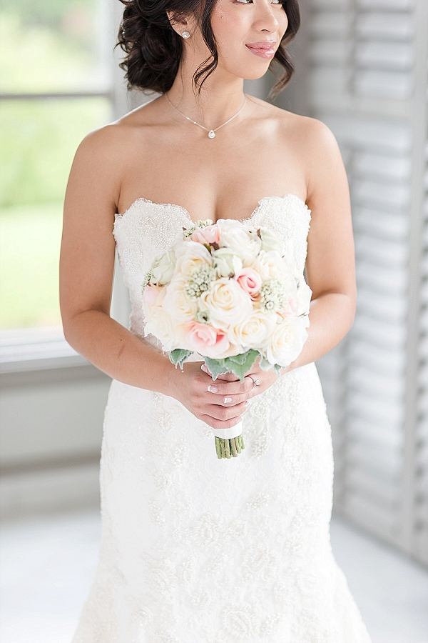 Handmade lace wedding dress and bridal bouquet