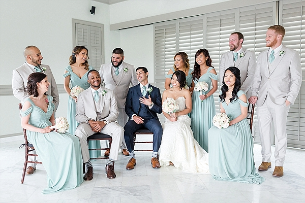 Mint colored bridesmaid and groomsman outfits