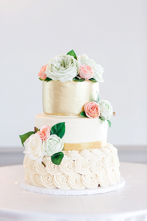 Gold mint and pink wedding cake with silk flowers