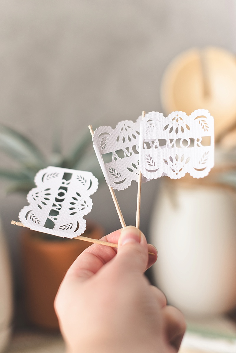 Adorable papel picado food pick flags made with Cricut machine and white cardstock for your wedding or bridal shower