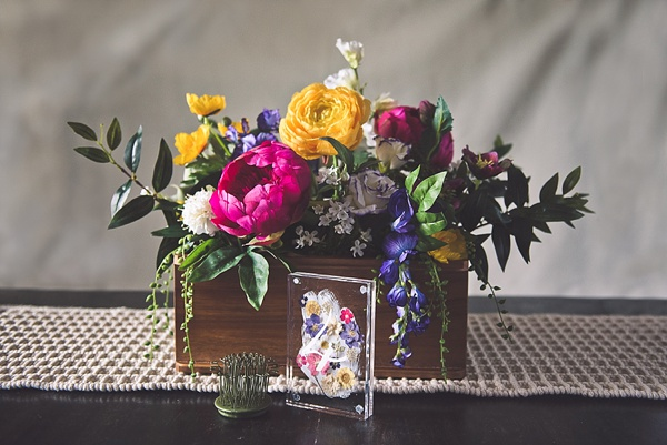 Vibrant wedding centerpiece with acrylic table number