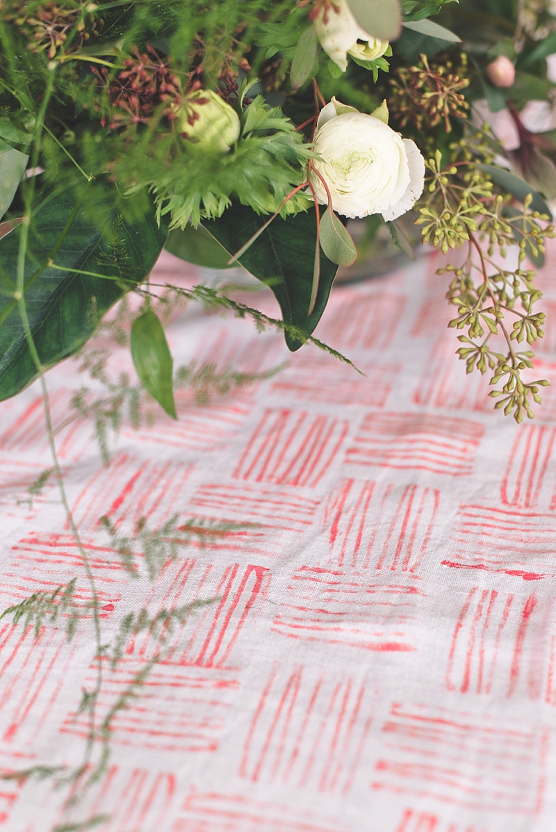Chic linen table runner with Pantone Living Coral modern design using a handmade stamp