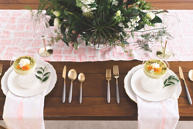 Naturally inspired sweetheart table with hand stamped table runner and gray terrazzo coasters for unique wedding reception design