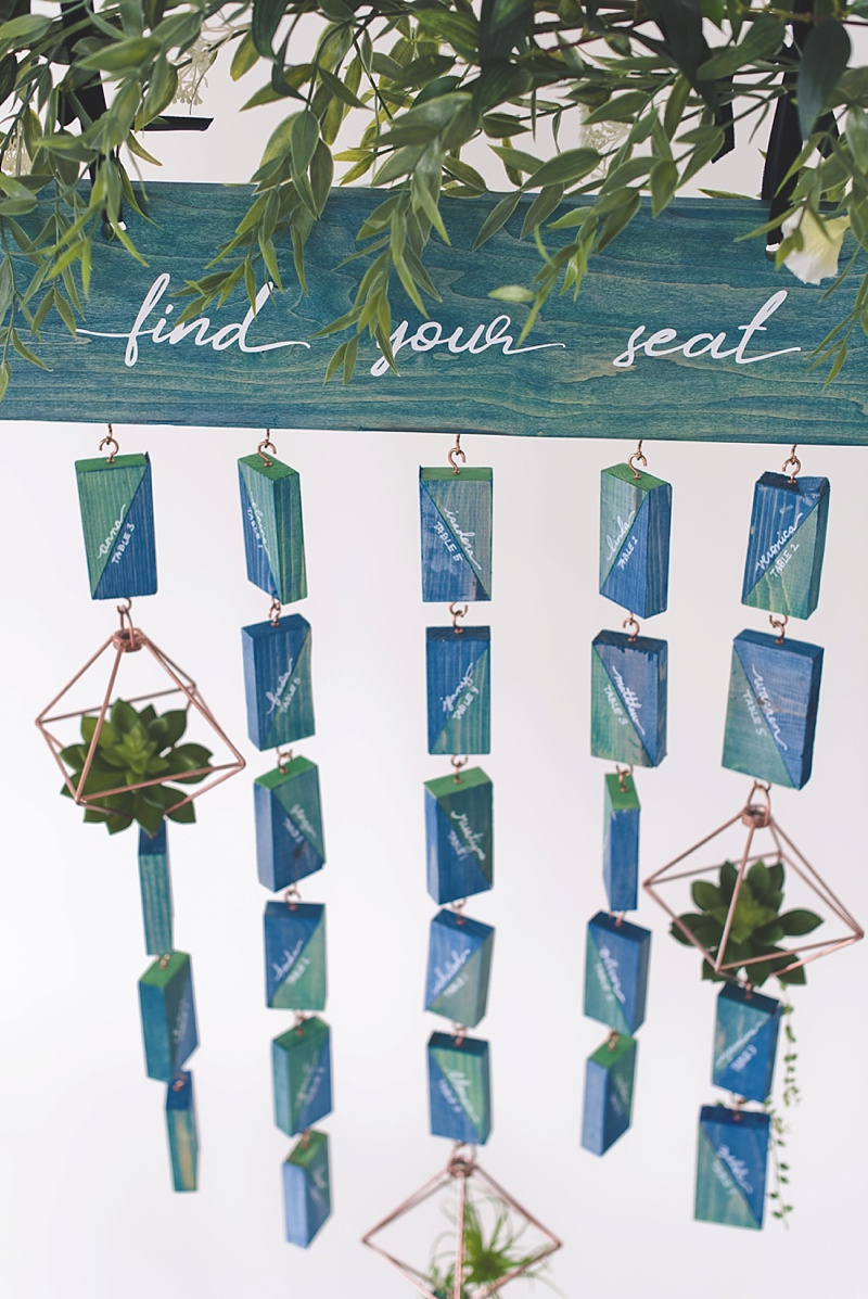 Eco inspired wedding seating chart using upcycled wood scraps with stain paint