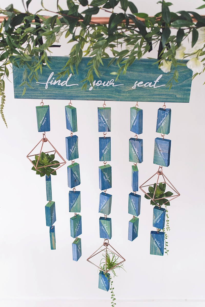Unique navy blue and teal stained wood for hanging wedding seating chart DIY project
