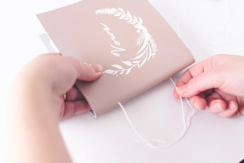 Rose gold wedding vow book with long stitch binding