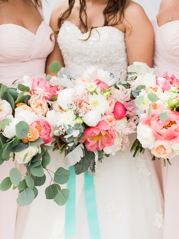 Pink orange and coral flowers in wedding bouquets