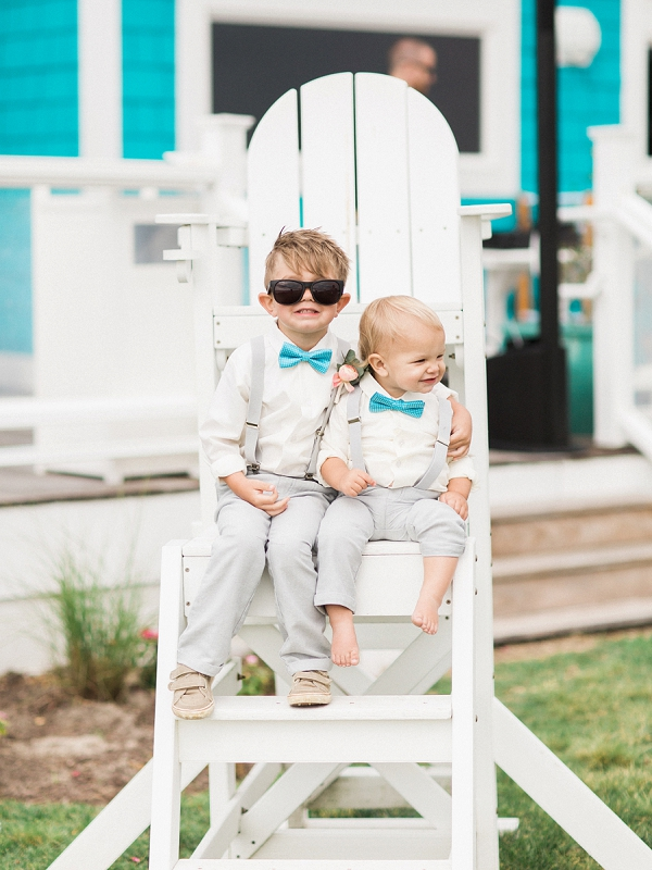 Adorable ring bearers with turquoise bow ties
