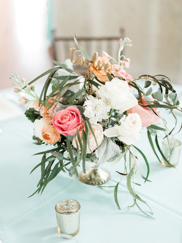 Gorgeous coastal wedding centerpiece with gold word table number