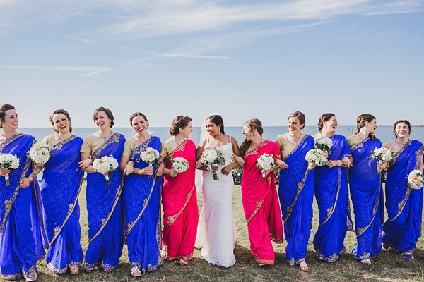 Wedding party in red and blue Indian sarees