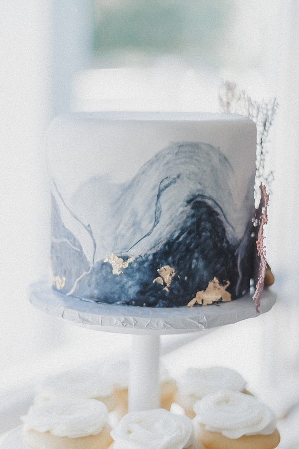Gorgeous coastal ocean wave inspired wedding cake with gold flecks and sea fan