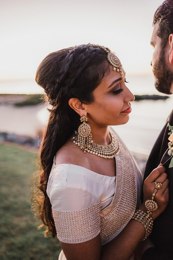 Beautiful bride in golden Indian saree and jewelry