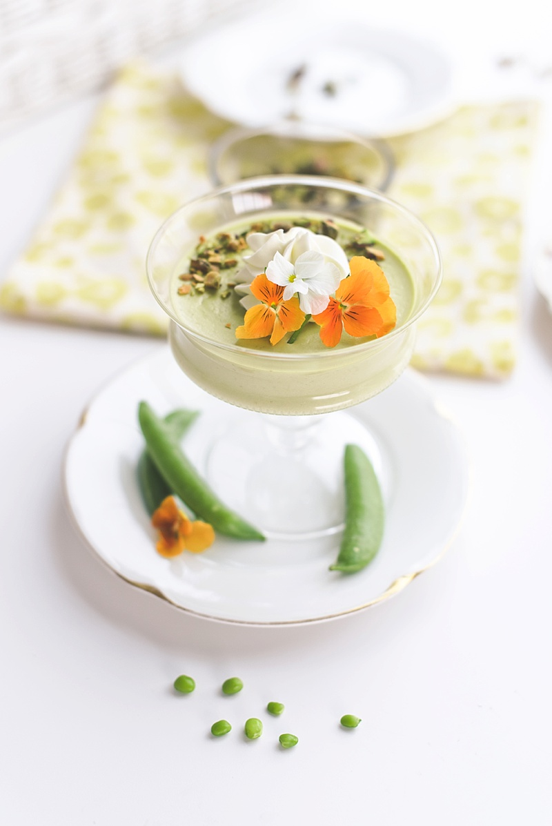 Sweet pea and lemon panna cotta with edible flowers and pistachios