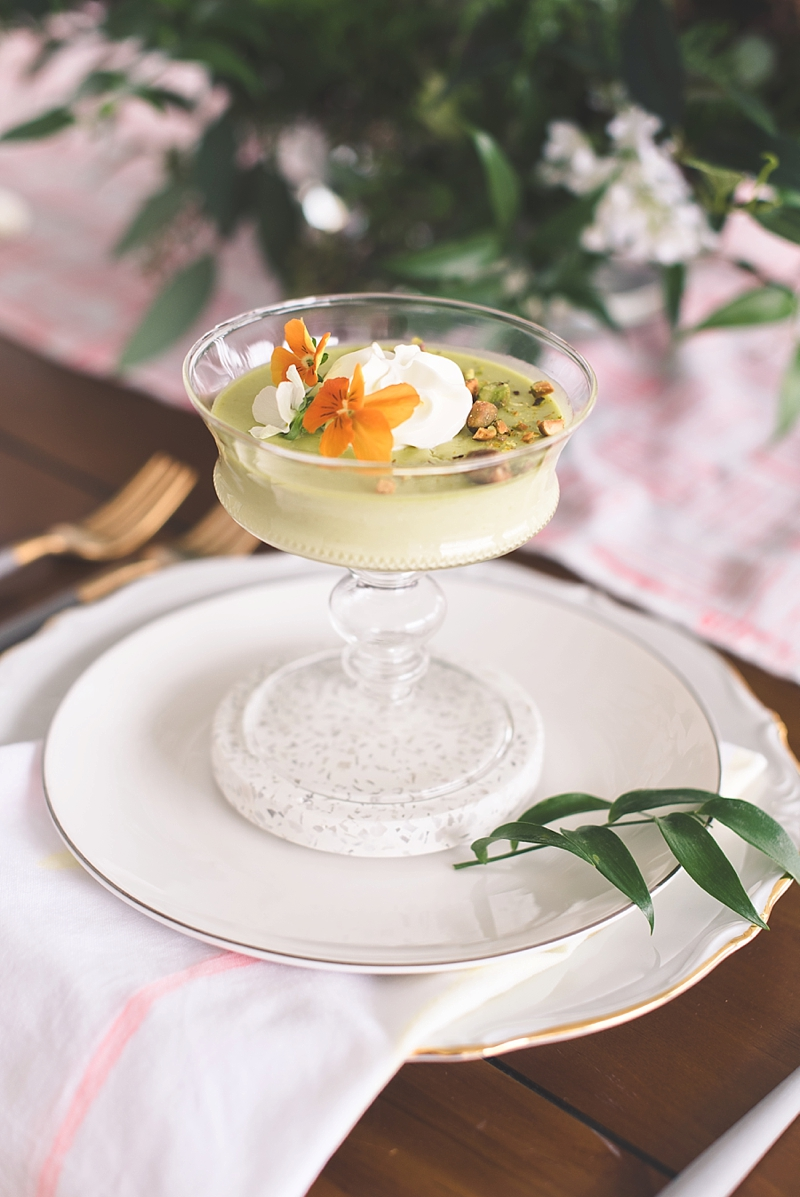 Spring inspired sweet pea panna cotta with edible flowers on gray terrazzo coasters