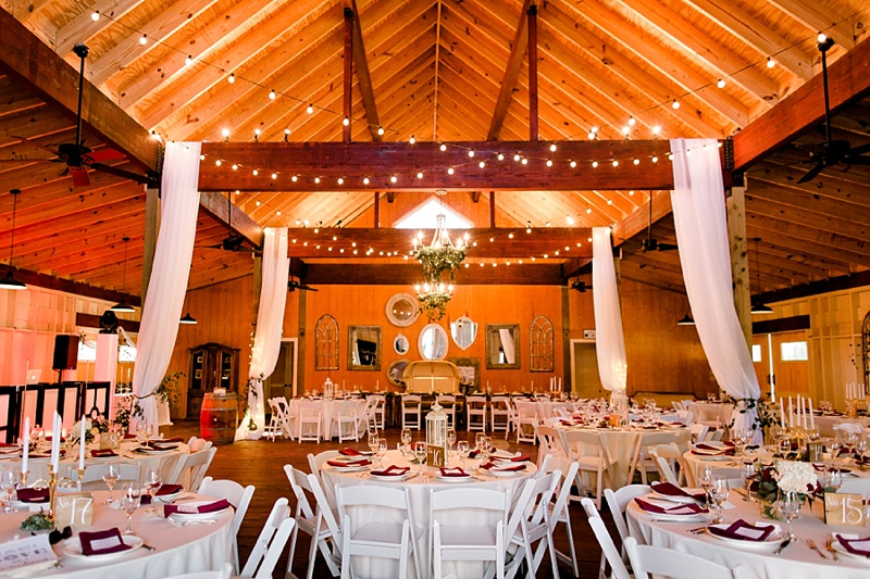 Elegant rustic barn wedding with drapery and bistro lights