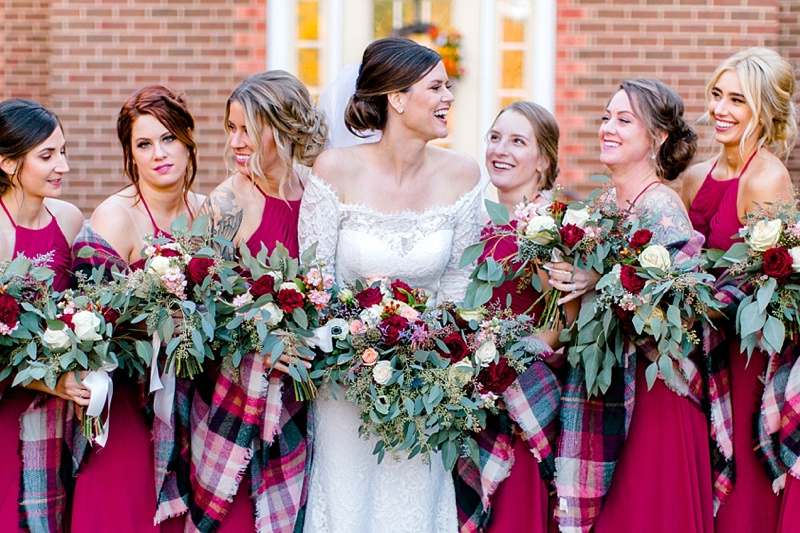 Gorgeous bridesmaids in red dresses and plaid shawls for fall Virginia wedding