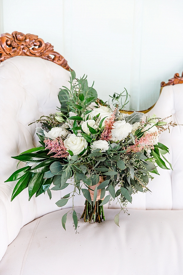 Neutral fall wedding bouquet with white roses and eucalyptus