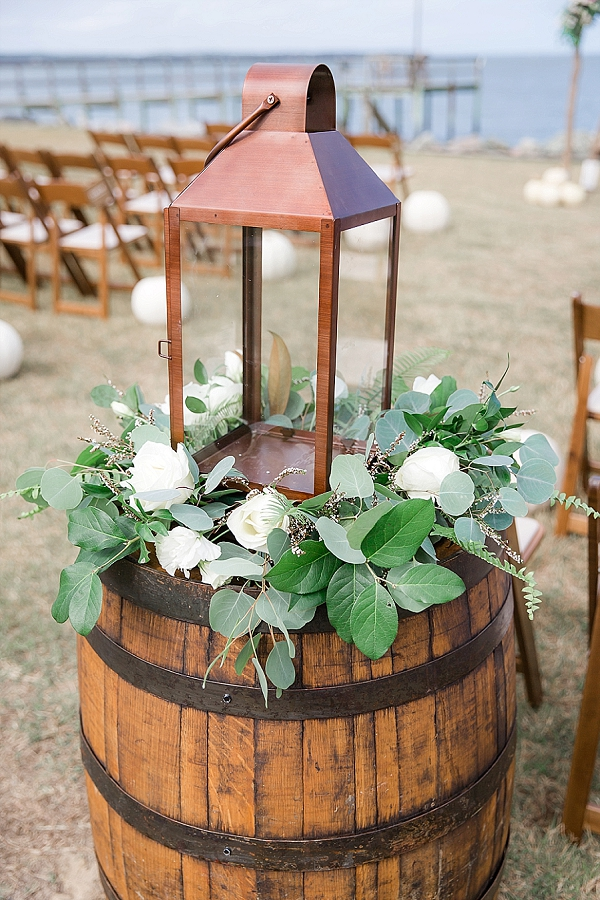 Giant bronze lantern with eucalyptus details for wedding ceremony decor