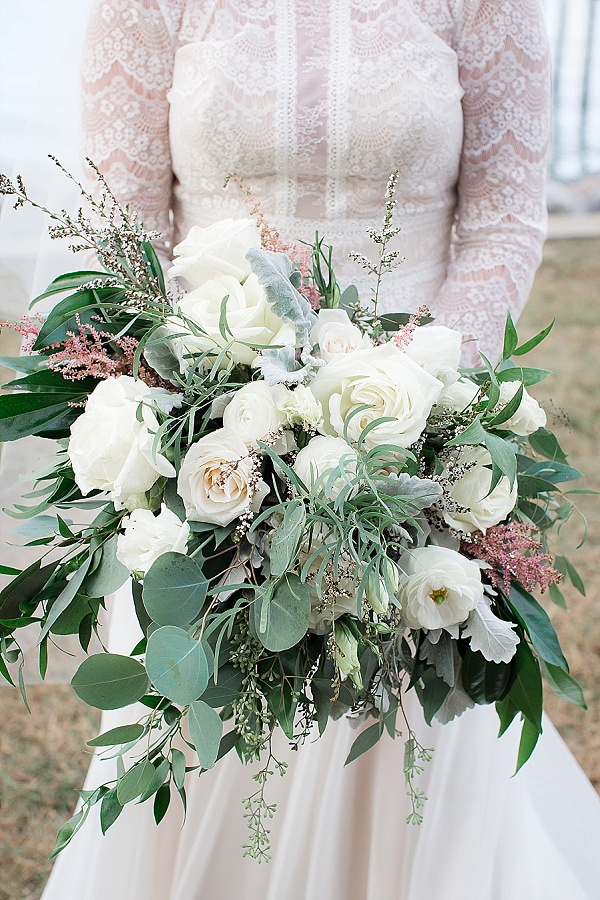 Overflowing bridal bouquet with eucalyptus and roses