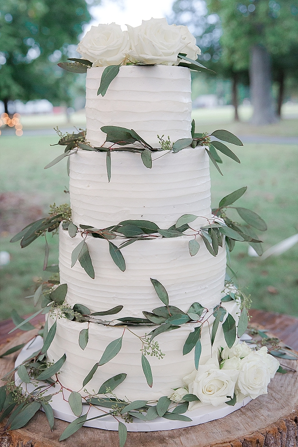 Classic textured white wedding cake with eucalyptus