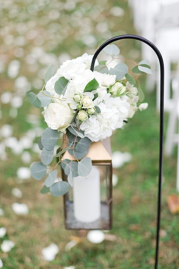 Wedding ceremony aisle ideas with hanging gold lantern and hydrangeas