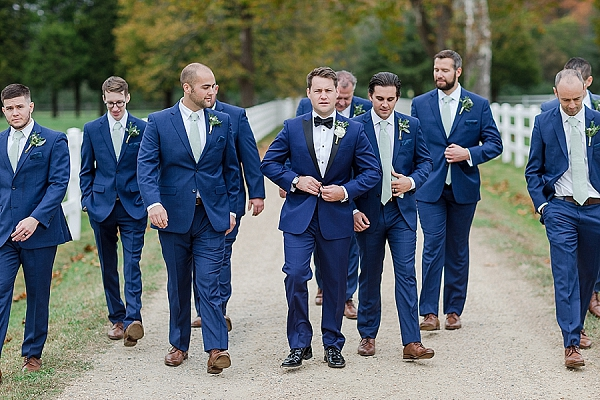 Groomsmen in black and blue stylish Calvin Klein tuxedos