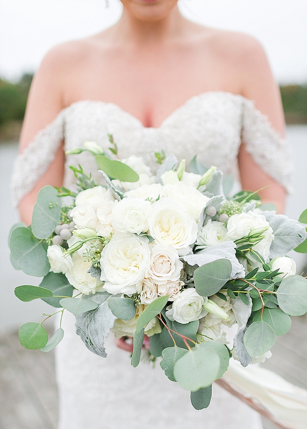 Overflowing bridal bouquet of silver dollar eucalyptus and garden roses