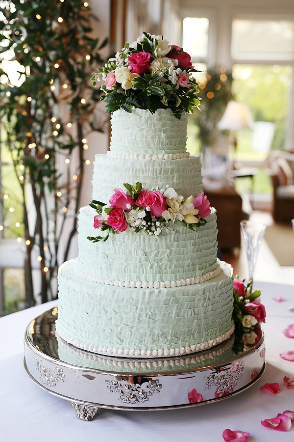 Tiered mint colored wedding cakes with tons of ruffles