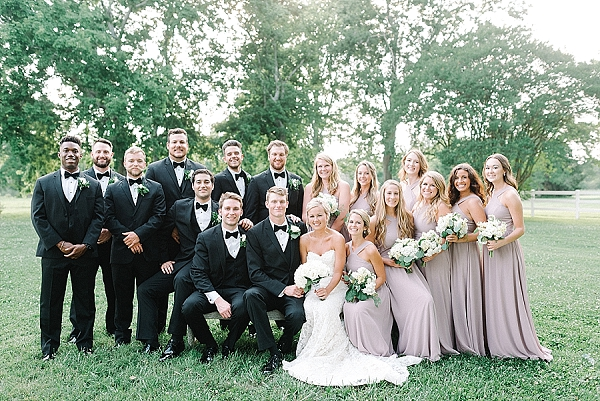 Black tie wedding style with lavender bridesmaid dresses