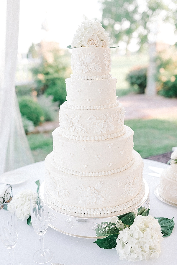 Gorgeous all white wedding cake with bas relief sugar art