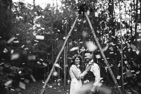 Gorgeous confetti filled wedding ceremony moment