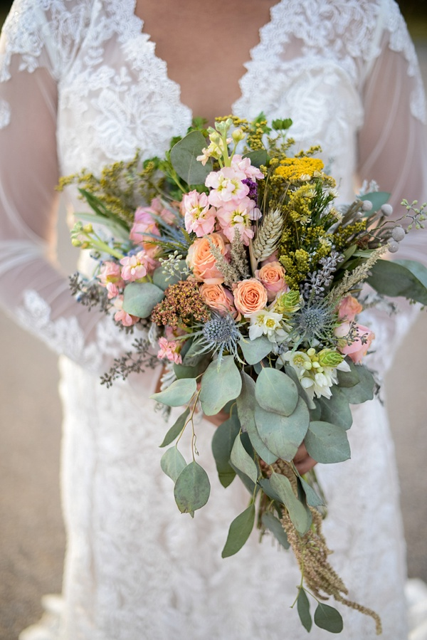 Colorful wheat and wildflowers wedding bouquet for boho bride