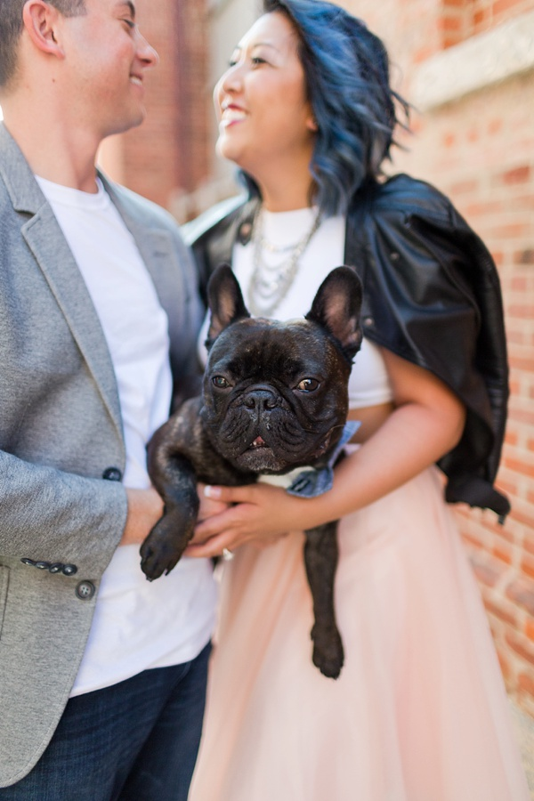 Bride and groom and their Frenchie pup