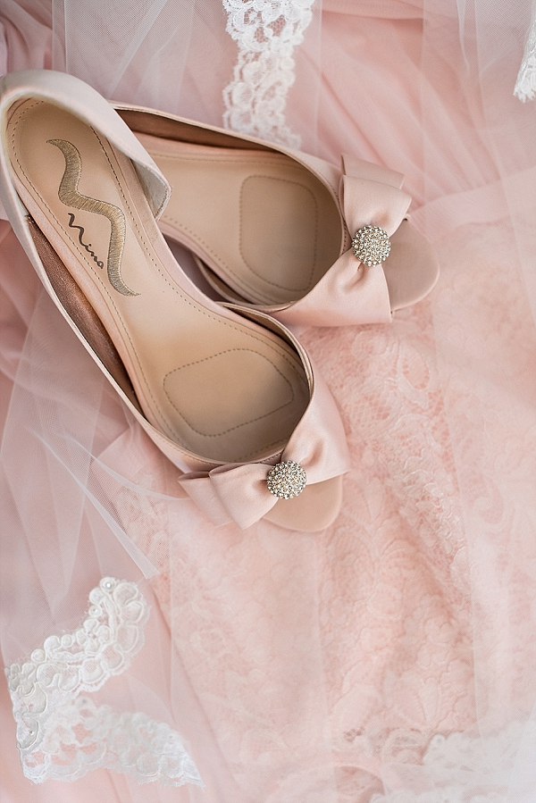 Blush pink wedding shoes with bows