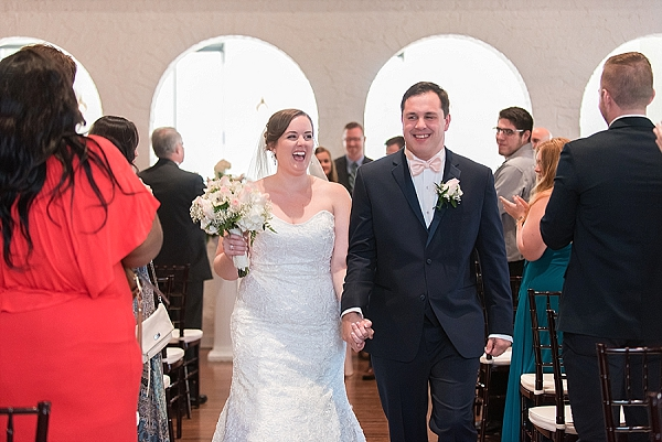 Post wedding ceremony excitement with bride and groom at Historic Post Office in Hampton Virginia