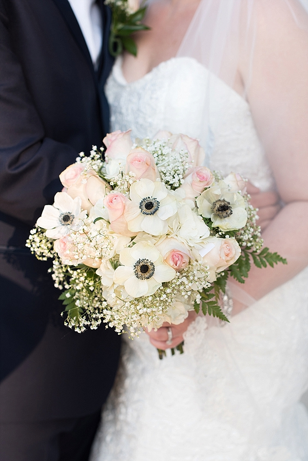 Bridal bouquet of pink roses anemones and white babys breath