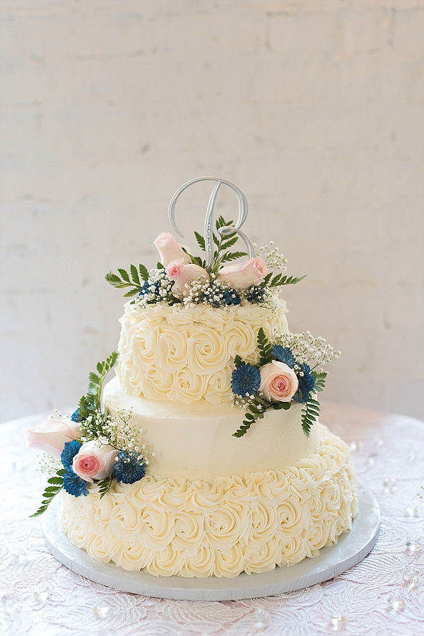 Traditional styled gluten free wedding cake with pink roses