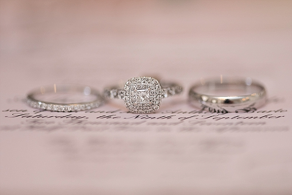 Silver wedding rings with a solitaire halo