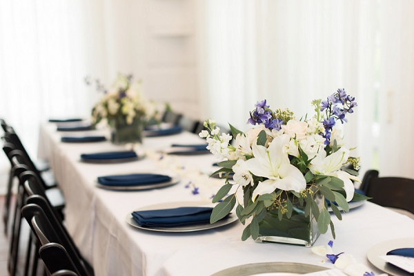 Simple and elegant white and navy blue wedding centerpiece for classic wedding