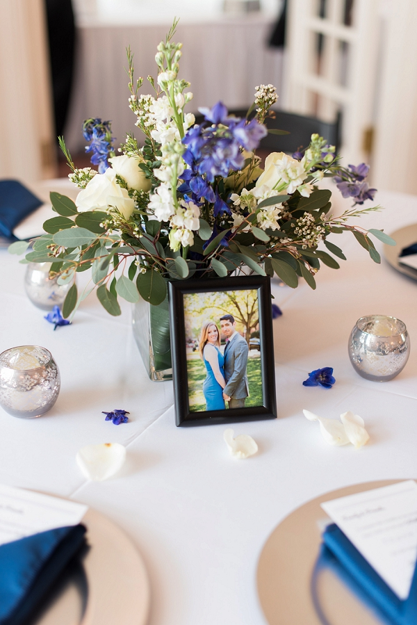 Low wedding centerpiece with photo of couple for classic wedding idea
