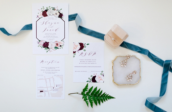 Modern wedding invitation with geometric design and pink flowers