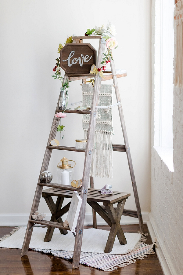 Modern boho wedding decor ladder with love sign and macrame wall hanging