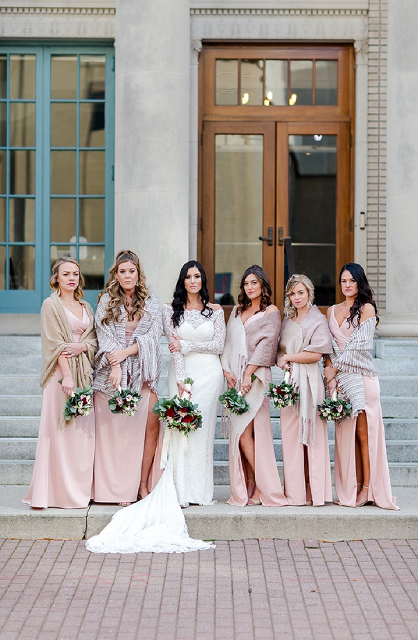 Bridesmaids in pink dresses and neutral scarves