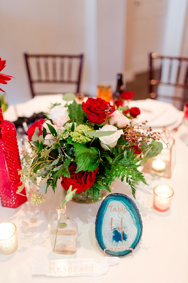 Red and white flowers with blue agate stone table number